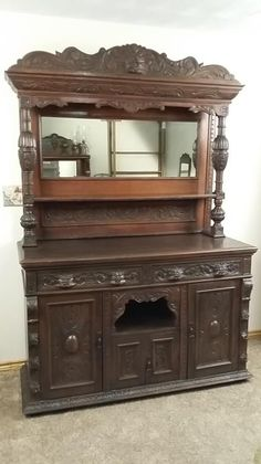 antique hand carved northwind face buffet